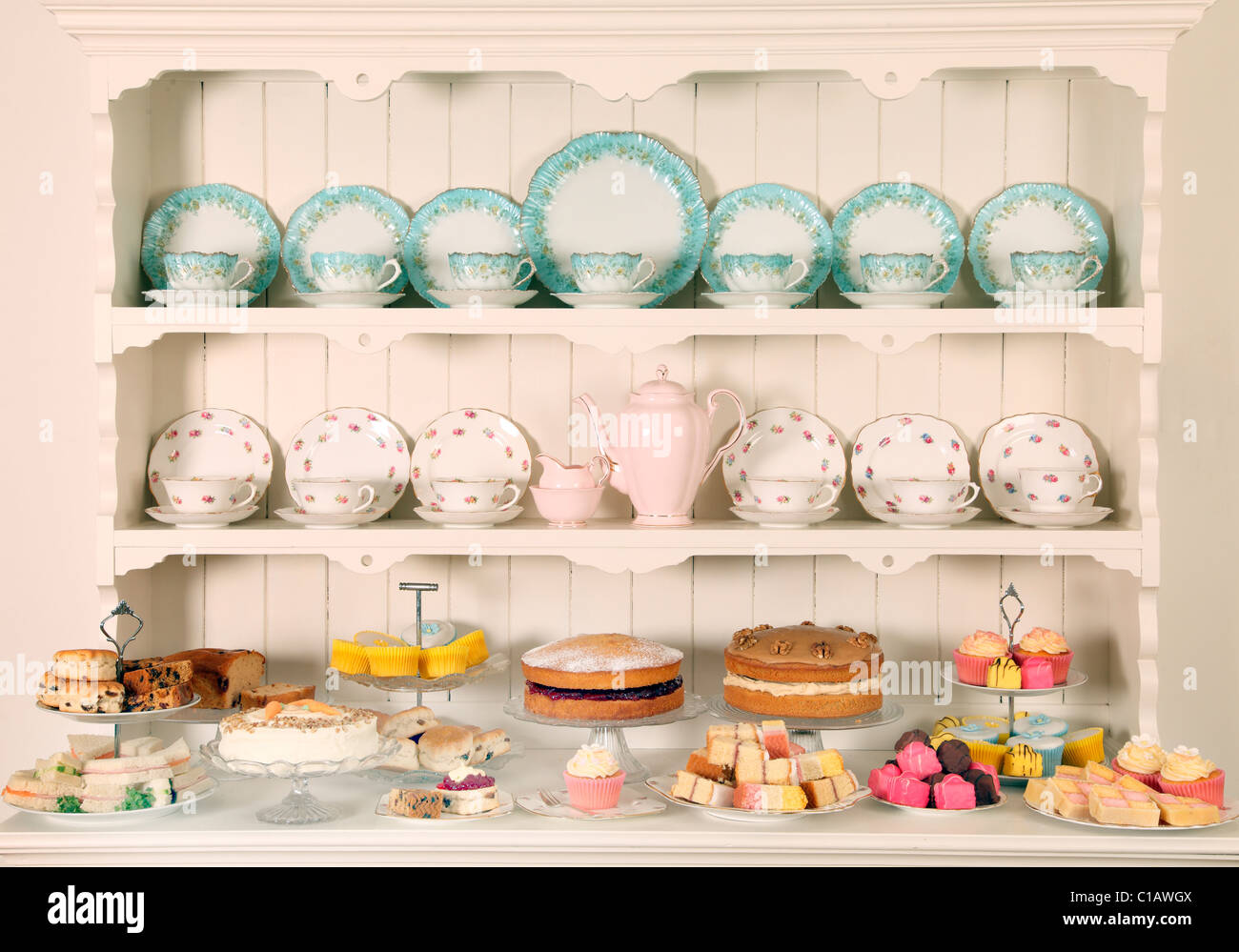 VINTAGE CHINA TEACUPS WITH CAKES - Stock Image