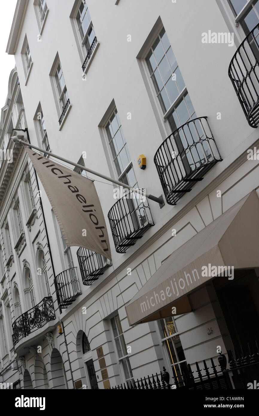 Main entrance and front facade of the popular high end salon and boutique Michael John in Albermarle Street,Mayfair. - Stock Image