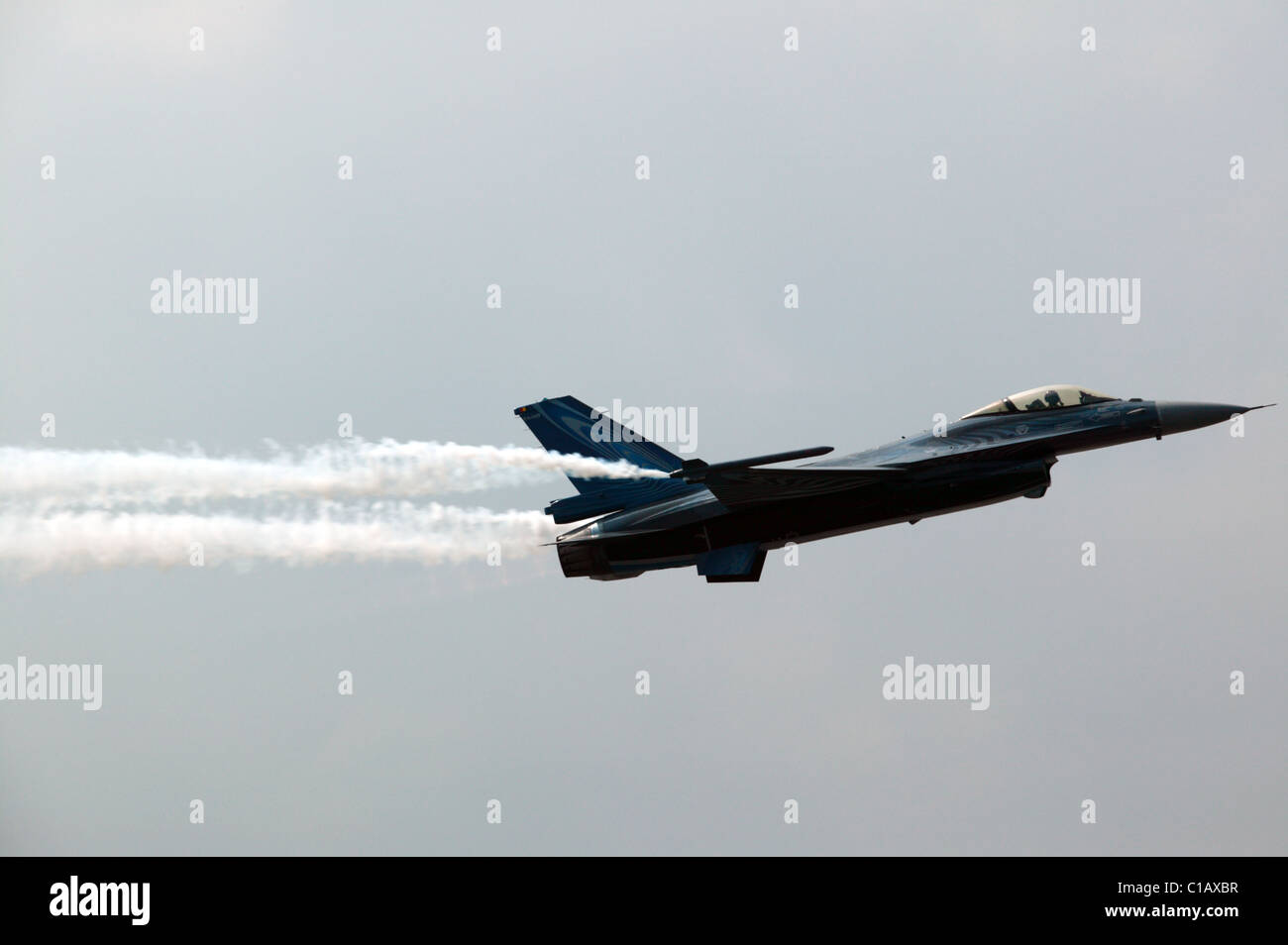 Lockheed Martin F-16 Fighting Falcon  performing a high alpha, slow-speed pass at Biggin Hill Air Show - Stock Image