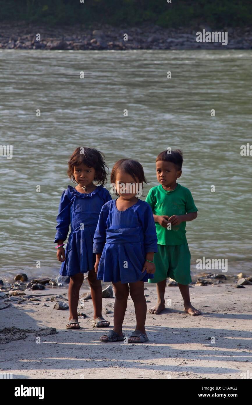 Local Nepali children on Sun Kosi river, Nepal, Asia - Stock Image