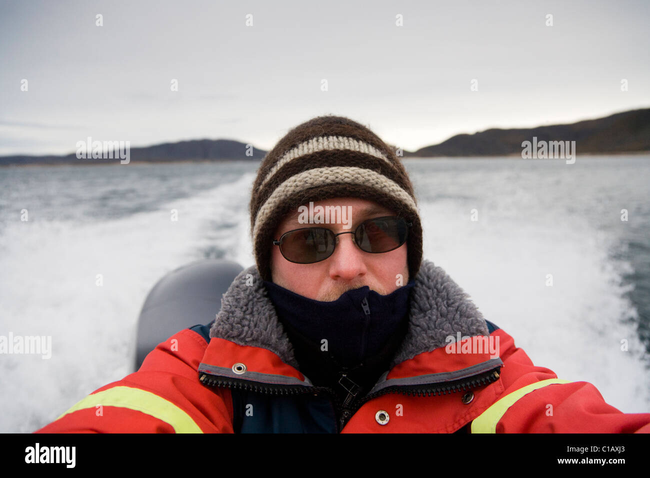 Passenger on a speedboat (self portrait), South Greenland. - Stock Image