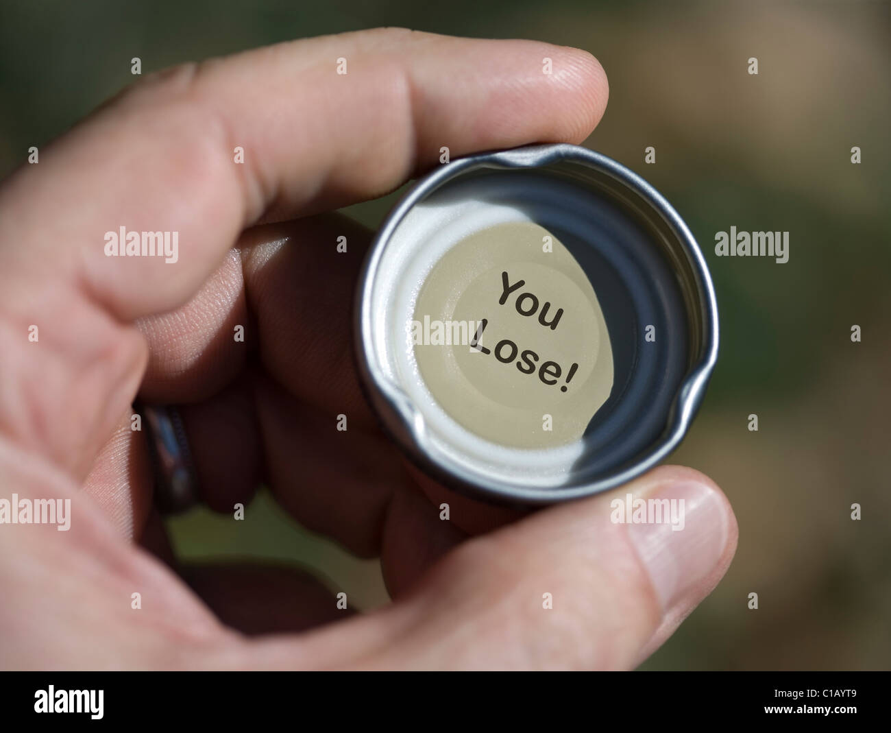 Inside of a bottle cap, with the words 'You Lose' - Stock Image