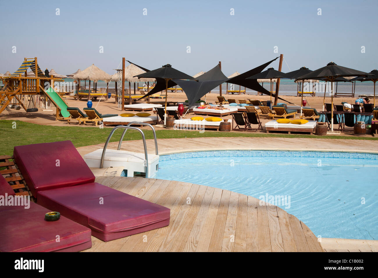 Seating area and pool at a beach bar in Sharm El Sheikh Nabq beach - Stock Image
