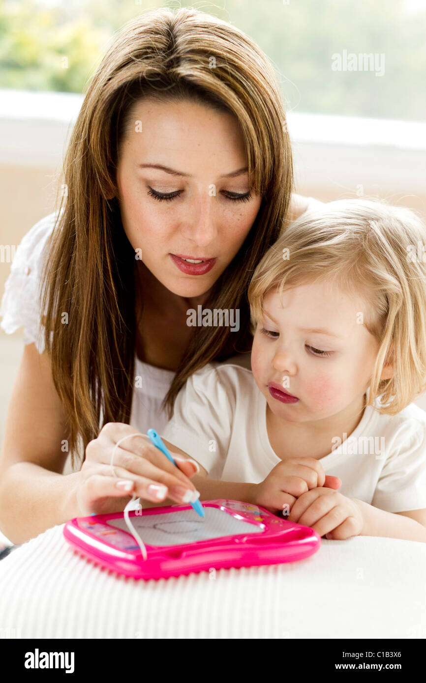 Mother and child writing/drawing - Stock Image