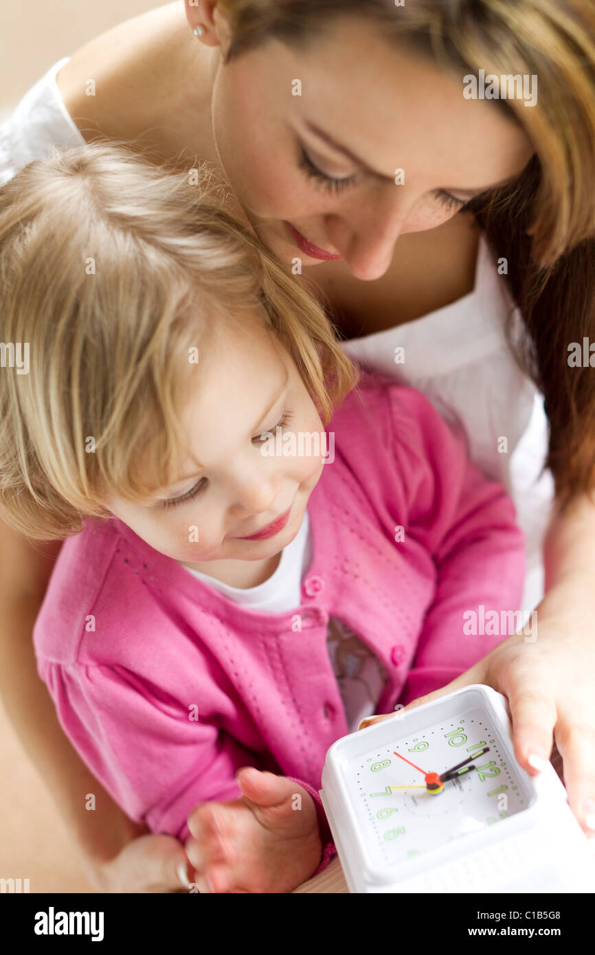 Mother and child with clock - Stock Image