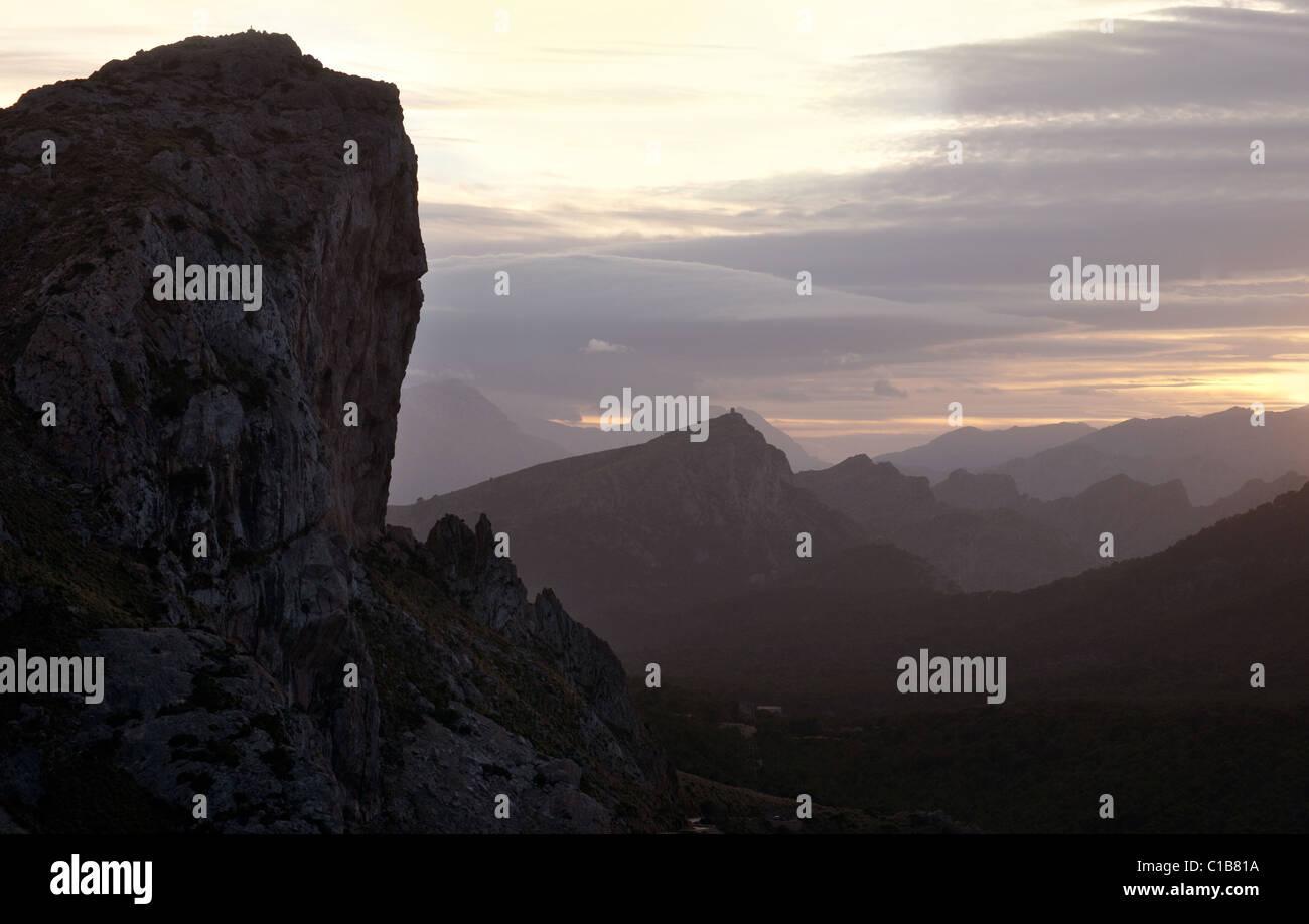 Mountain range view with medieval watchtower near Cap de Formentor, Tramuntana mountain range, Mallorca, Balearic - Stock Image