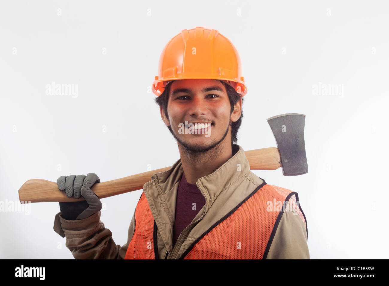 asian hard hat worker with an axe - Stock Image