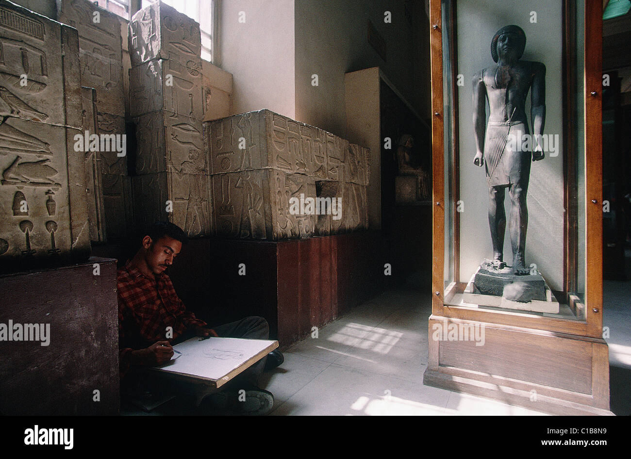Egypt, Cairo, Antiquity museum Student drawing a stele - Stock Image