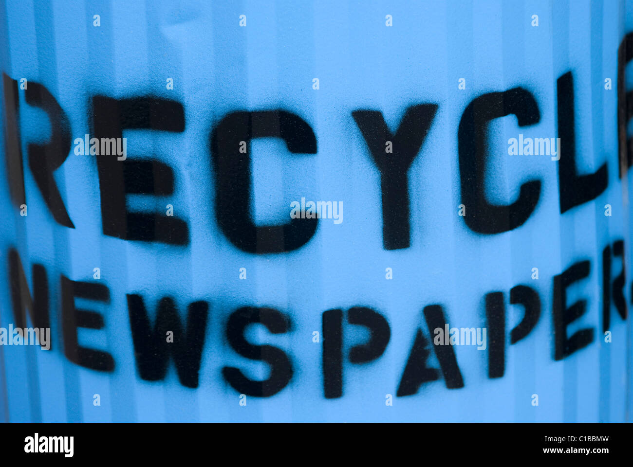 Blue recycle newspaper trash can Stock Photo