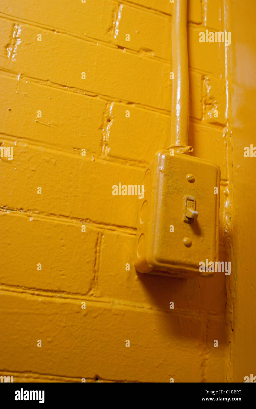 Industrial light switch painted yellow Stock Photo: 35286156 - Alamy