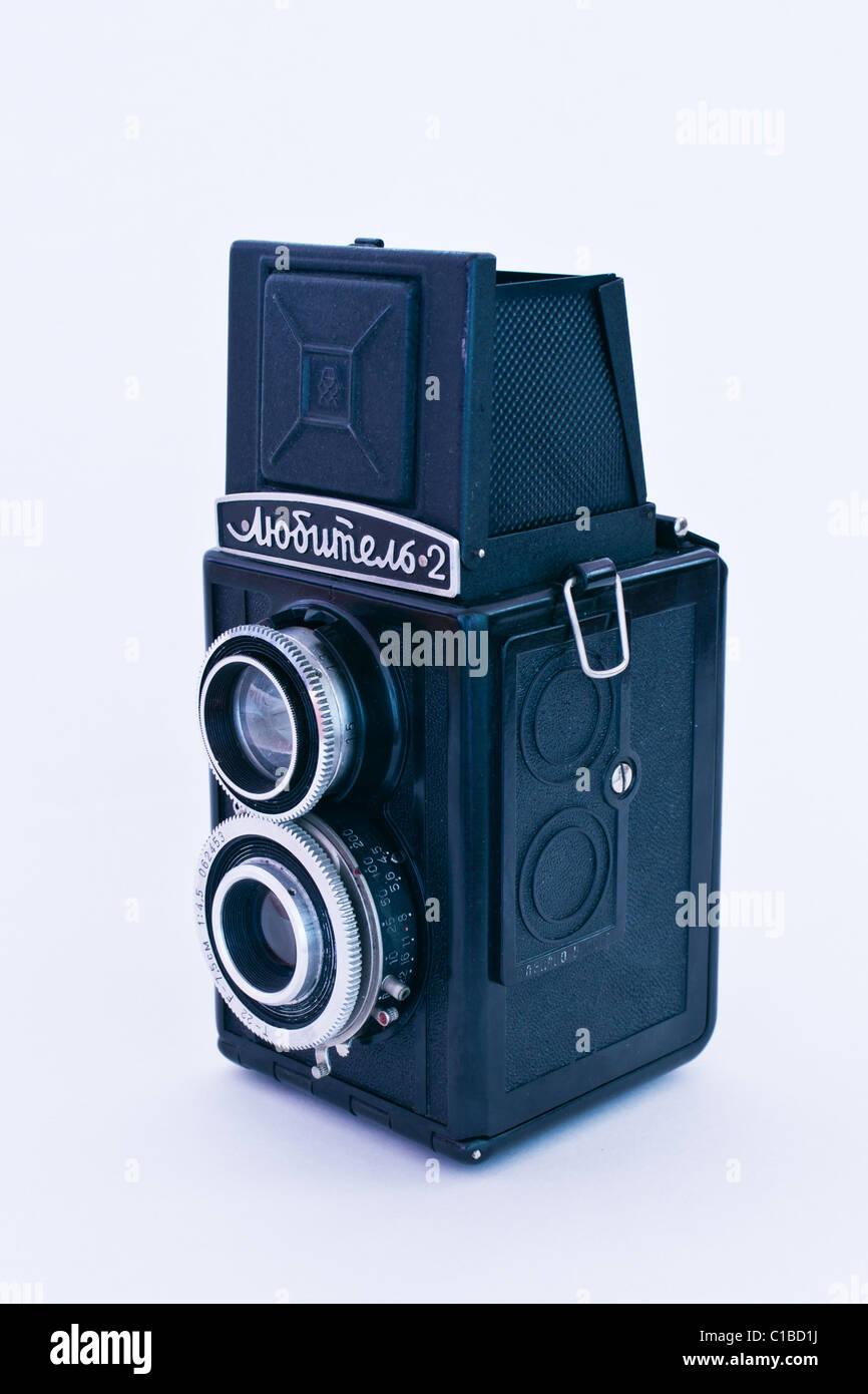 Old soviet camera Lubitel 2 isolated on white background - Stock Image