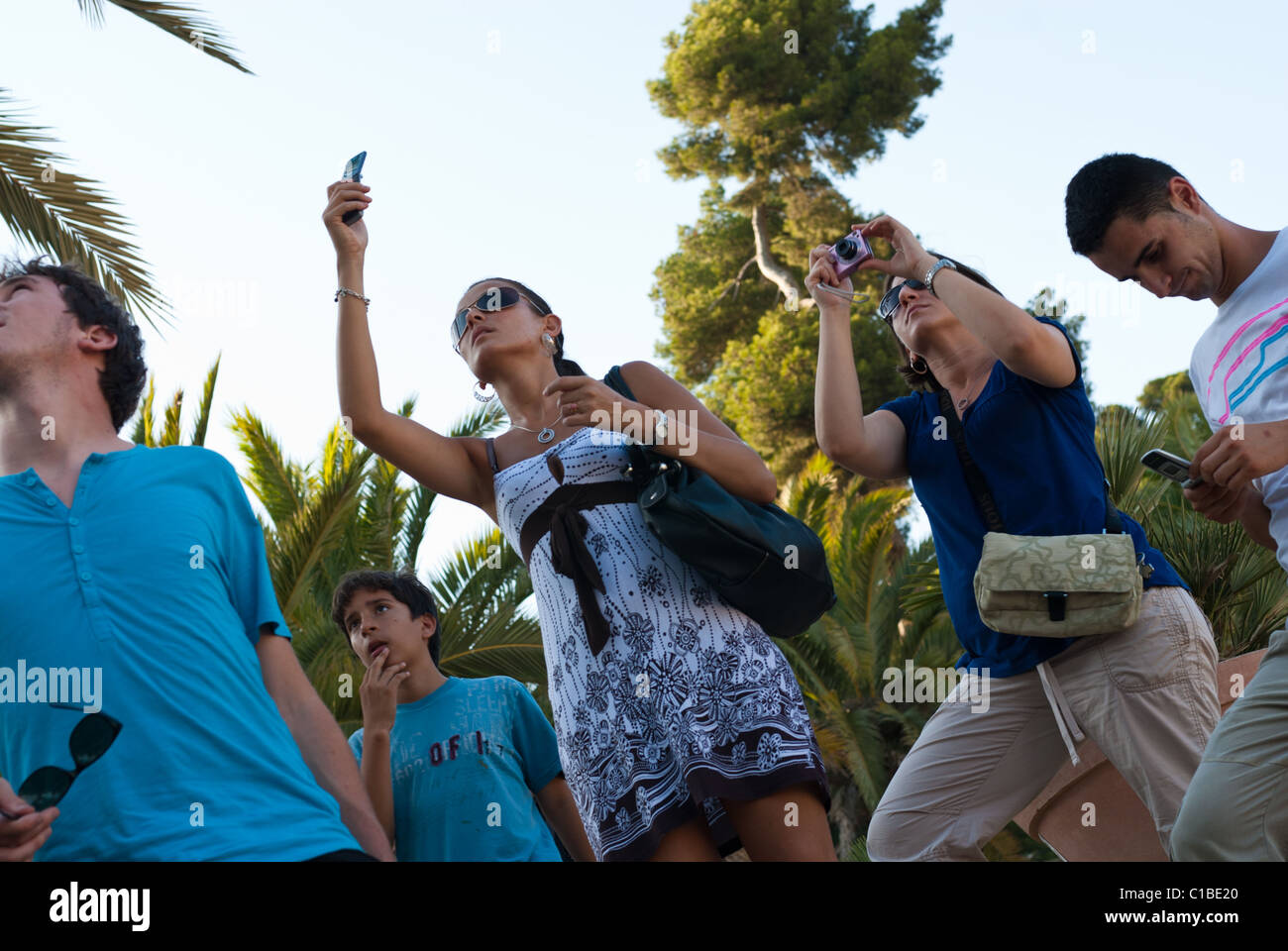 People photographing at Park Guell, Barcelona. - Stock Image