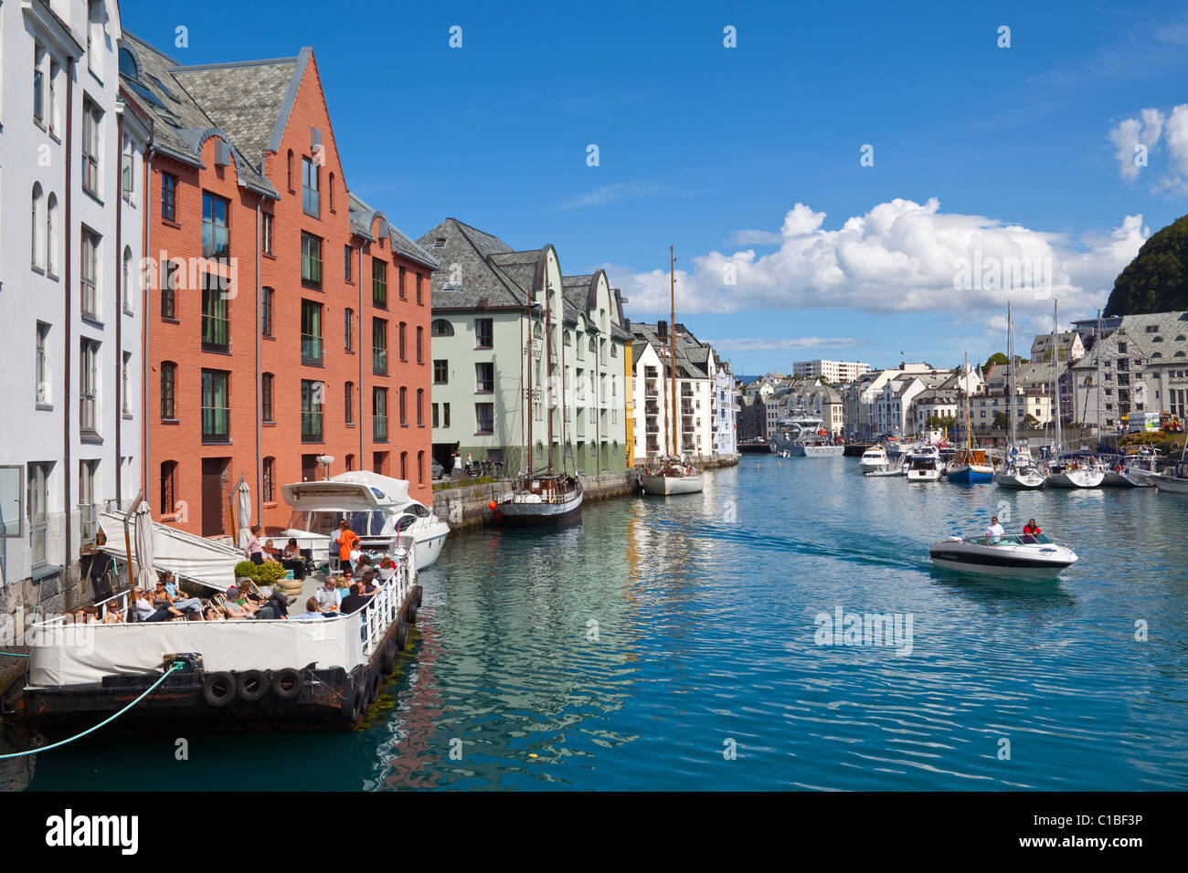Floating cafe in picturesque harbor, Alesund, Sunnmore, More og Romsdal, Norway - Stock Image
