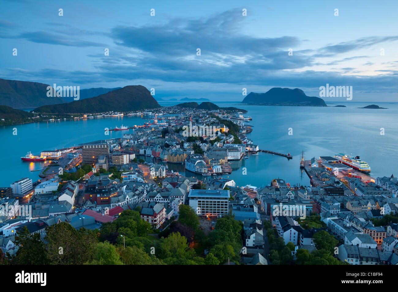 Elevated view over Alesund illuminated at dusk, Sunnmore, More og Romsdal, Norway - Stock Image