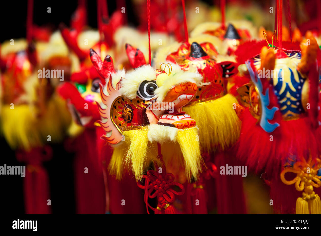 Chinese New Year decorations for sale at the Temple Street night markets.  Chinatown, Singapore - Stock Image