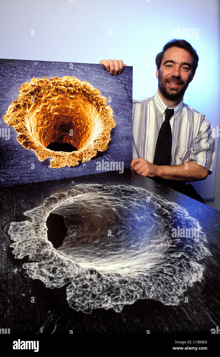 France Haute Garonne Toulouse Space Fragments at the CNES Christian Durin posing near two images which represent - Stock Image
