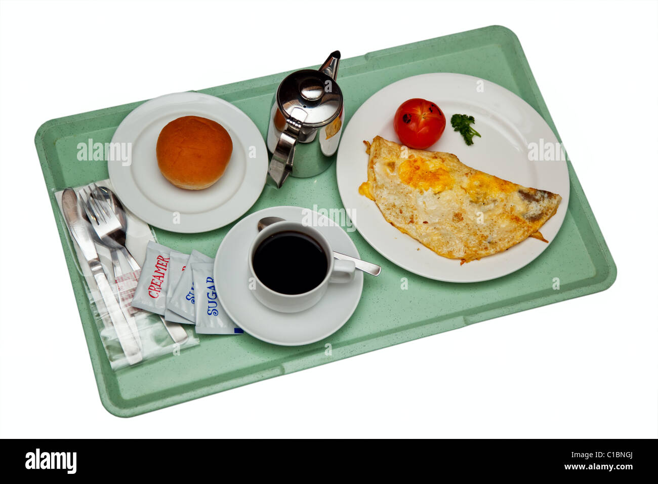 Breakfast on a tray isolated on white background - Stock Image