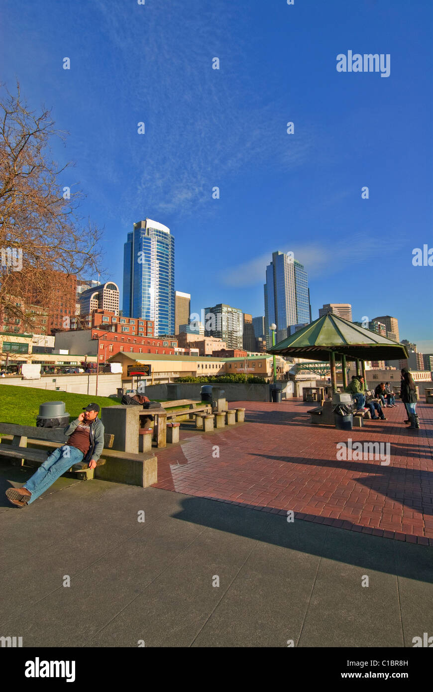 People Enjoy Sunny Winter Afternoon At Victor Steinbrueck Park Near Pike Place Market Seattle Washington USA - Stock Image