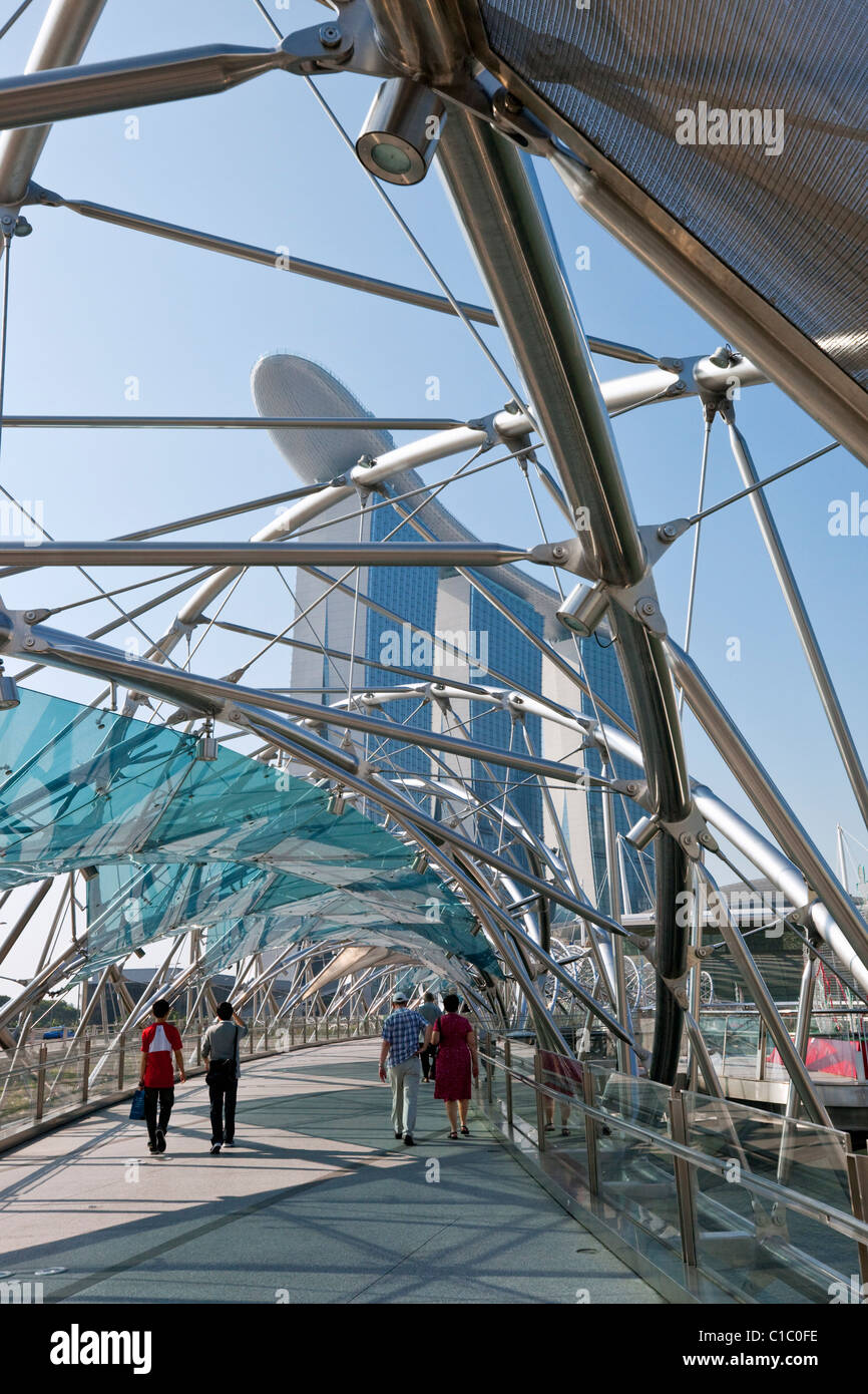 View along Helix Bridge to Marina Bay Sands Singapore.  Marina Bay, Singapore - Stock Image