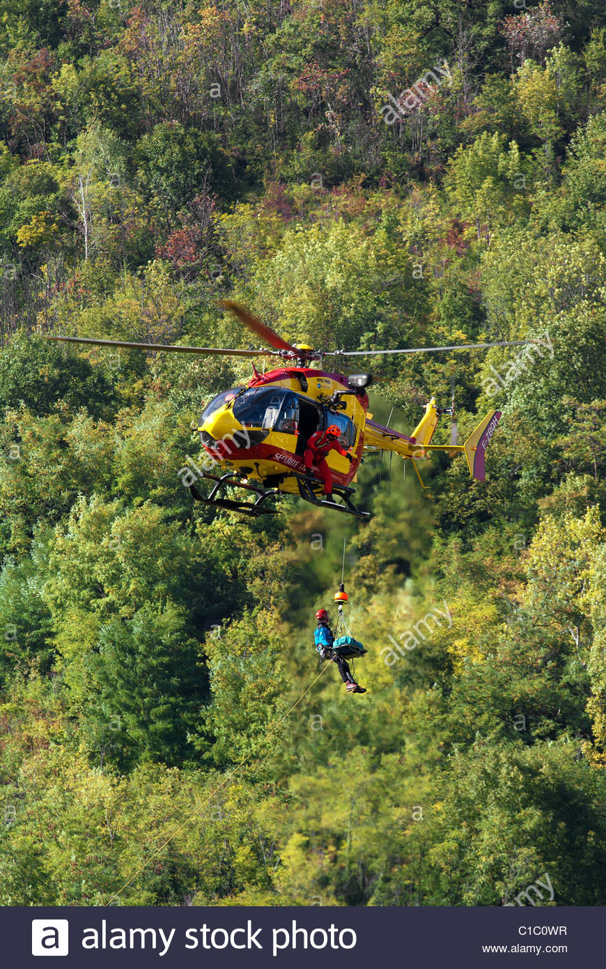 French search and rescue (sécurité civile) helicopter (EC 145) near Grenoble - Stock Image