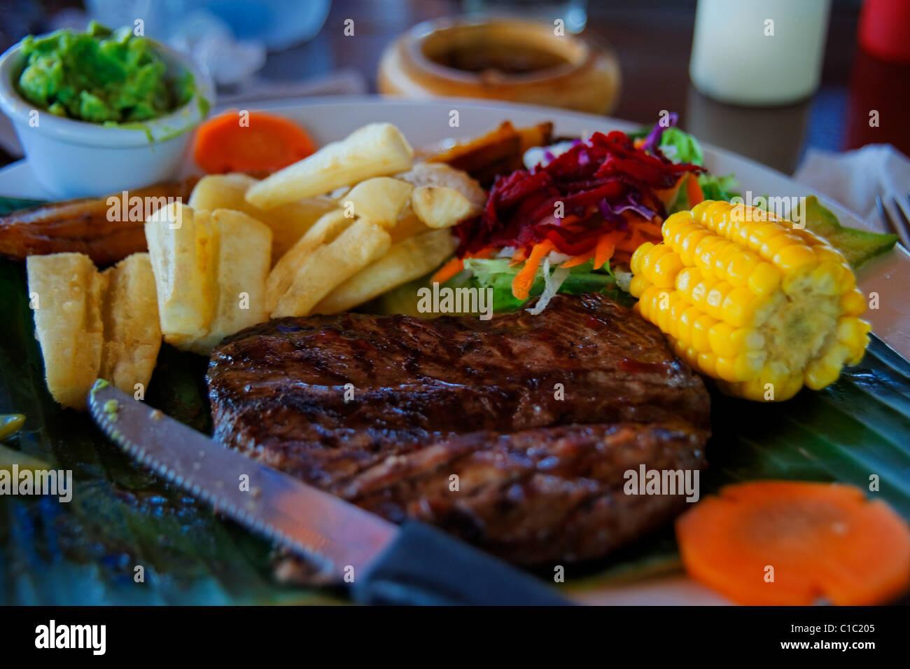 Steak and Yucca, Liberia near Airport, Guanacaste, Republic of Costa Rica, Central America - Stock Image