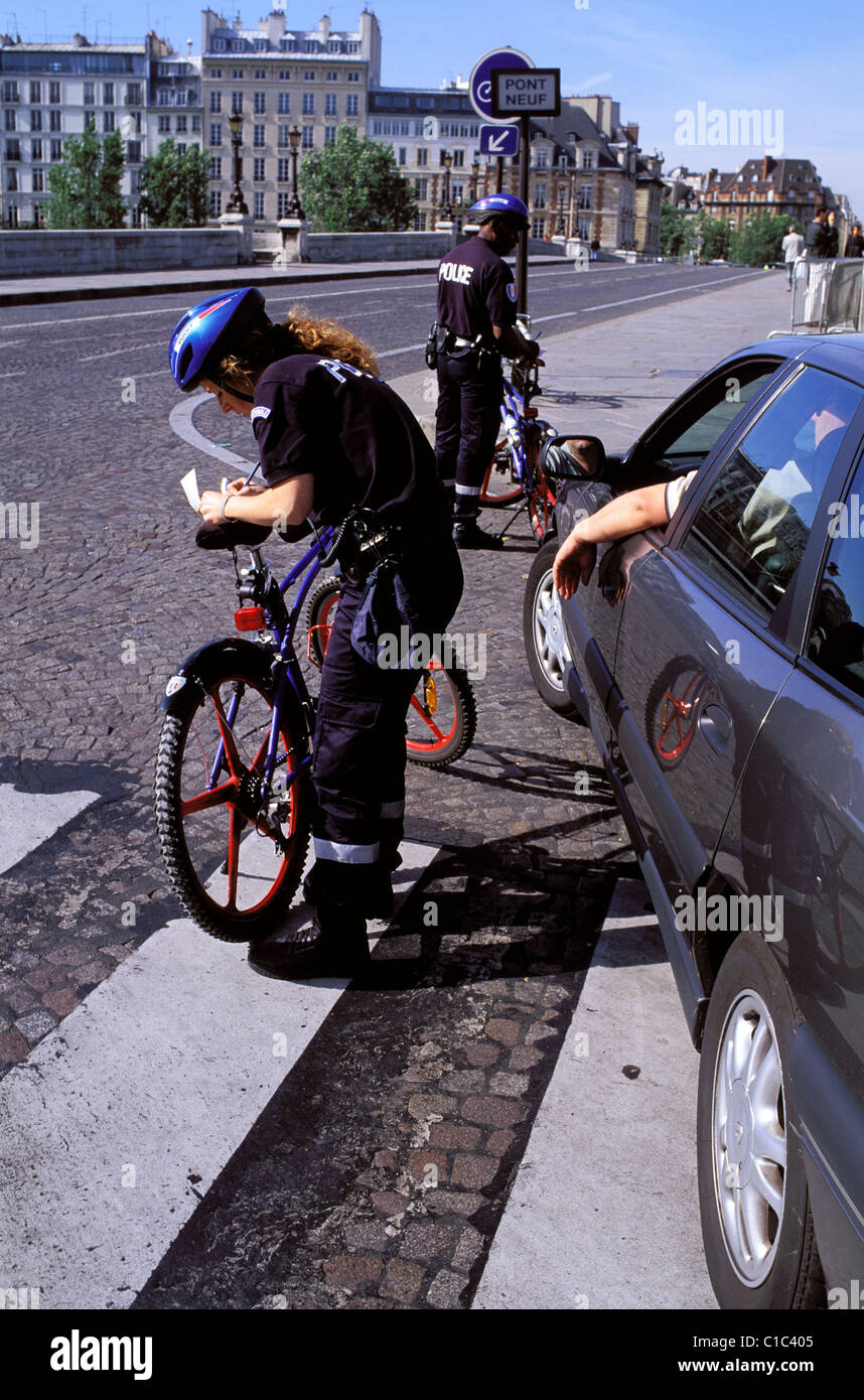 France, Paris, Police officers on bikes making controls - Stock Image