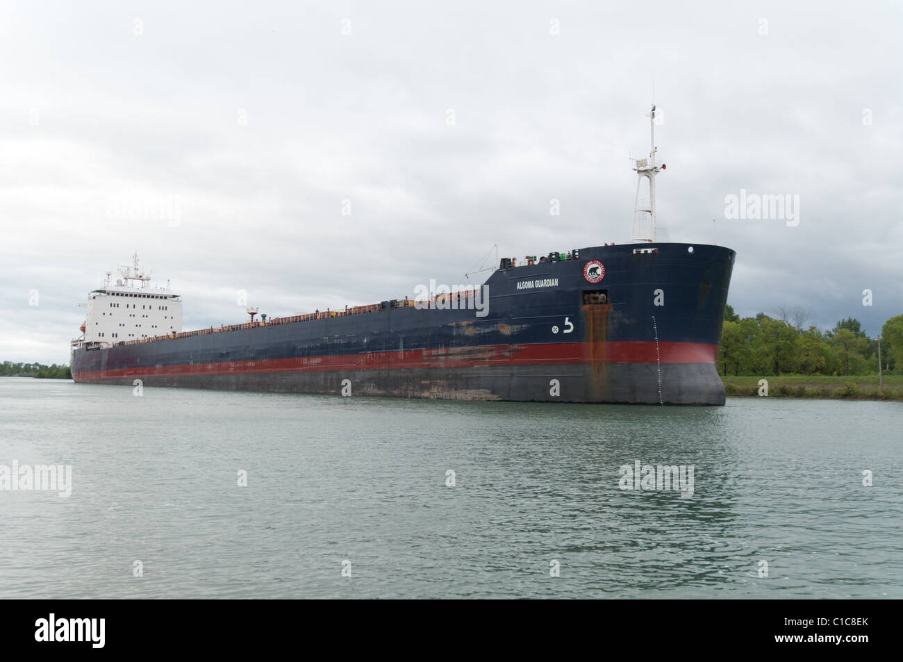 Bulk carrier 'Algoma Guardian' as seen navigating the Welland Canal, part of the St. Lawrence Seaway. - Stock Image