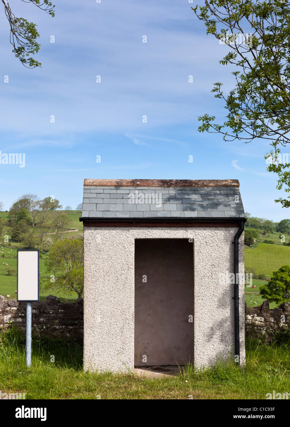 Bus stop - Small rural countryside bus stop and shelter with blank sign, England UK - Stock Image