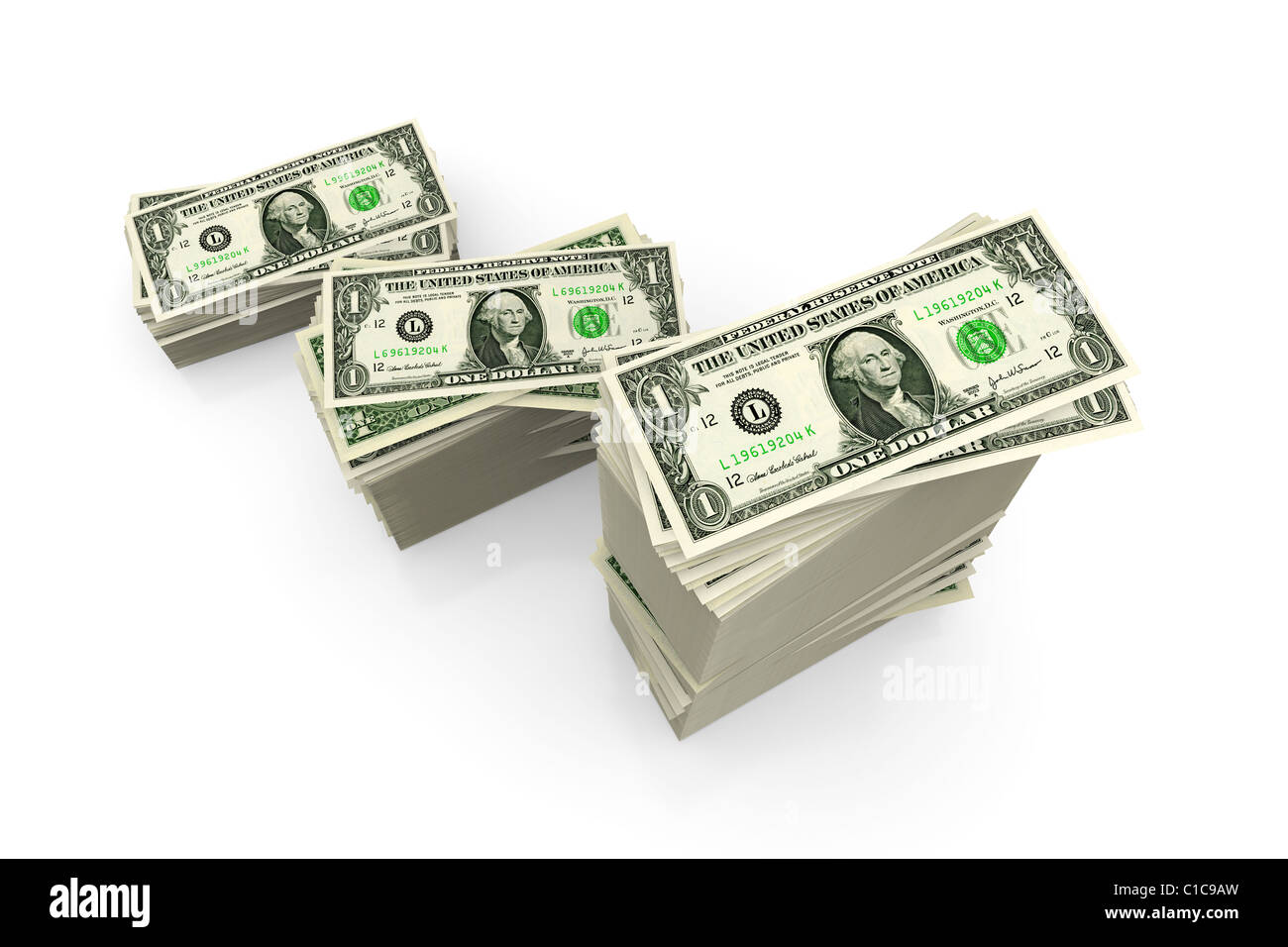 Dollar bills - piles of US currency on white - Stock Image