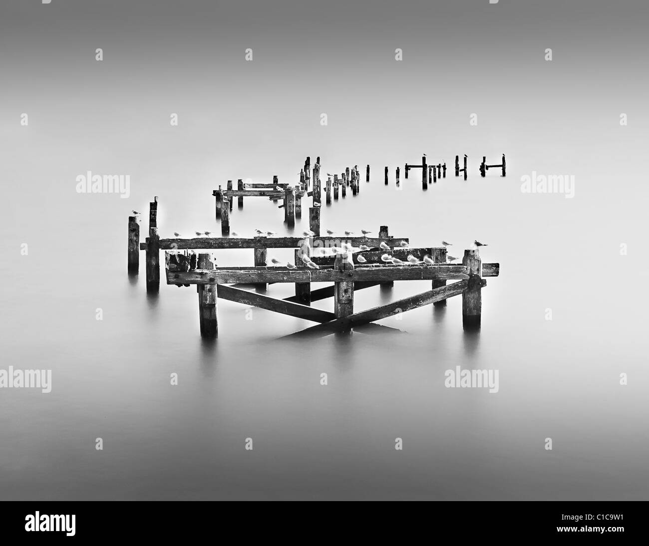 10 Stop Neutral Density Long Exposure Photograph Of Swanage's broken pier - Stock Image