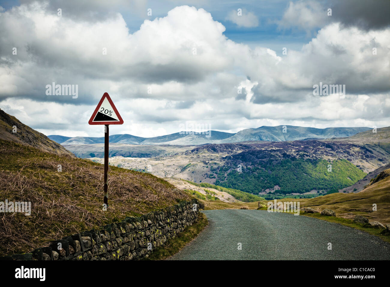 Gradient road sign on a rural mountain road hill at Honister Pass in Borrowdale in The Lake District, England UK - Stock Image