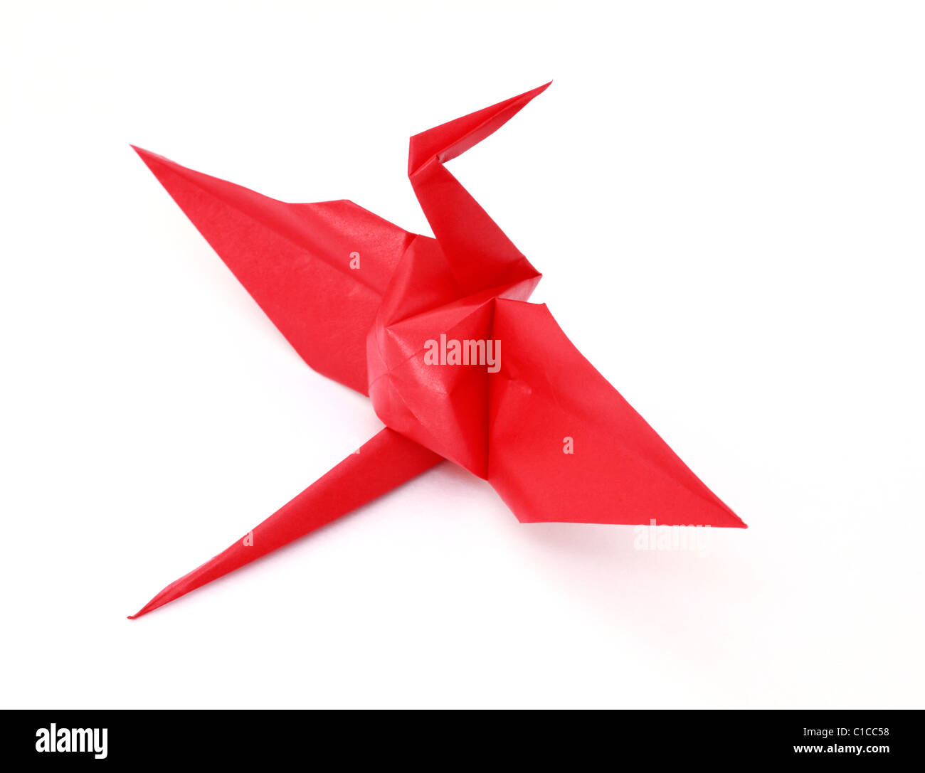 Close-up of a red origami bird sitting down. - Stock Image