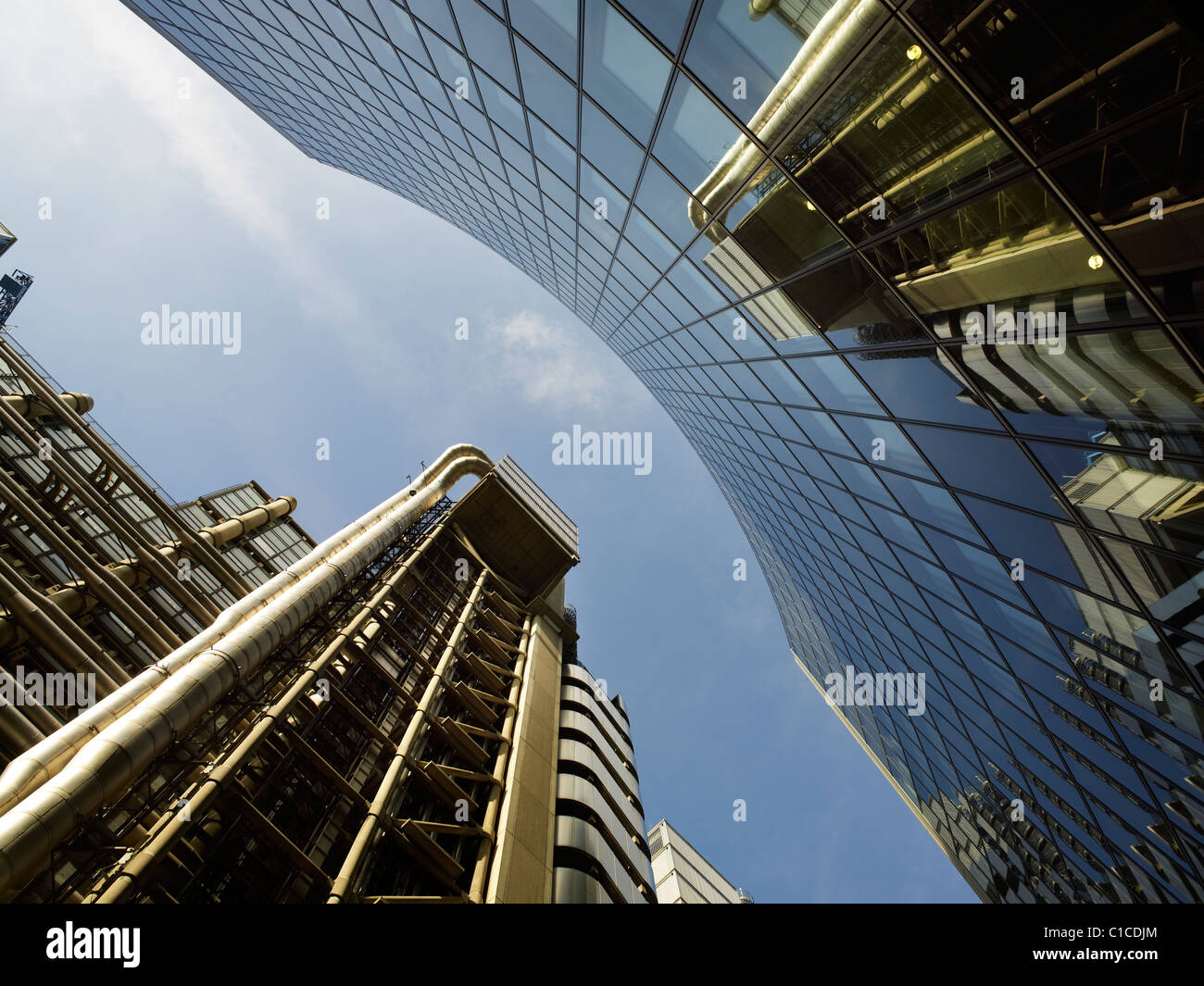 Lloyd's of London Building, Richard Rogers 1986, reflected in curved glass of Norman Foster's 2008 28 storey - Stock Image