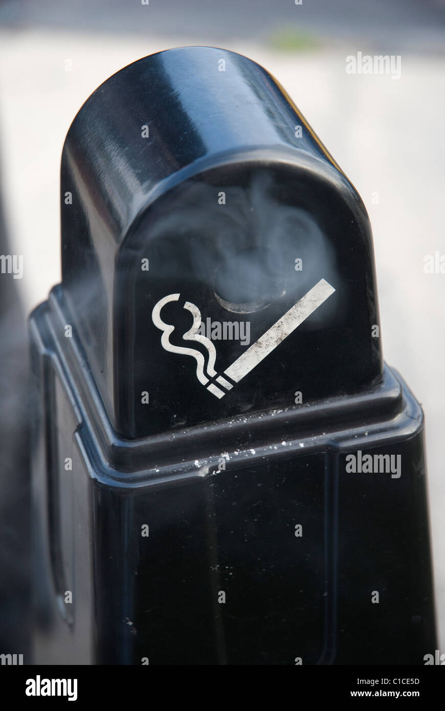 smoking cigarette receptacle at entrance to store - Stock Image
