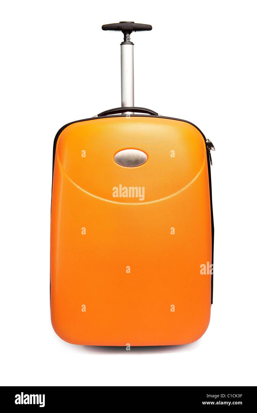 Orange suitcase for travel - Stock Image