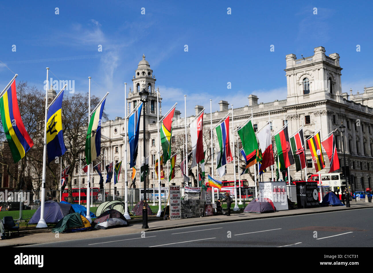 Parliament Square with Anti War Protestors and Flags, Westminster, London, England, UK - Stock Image