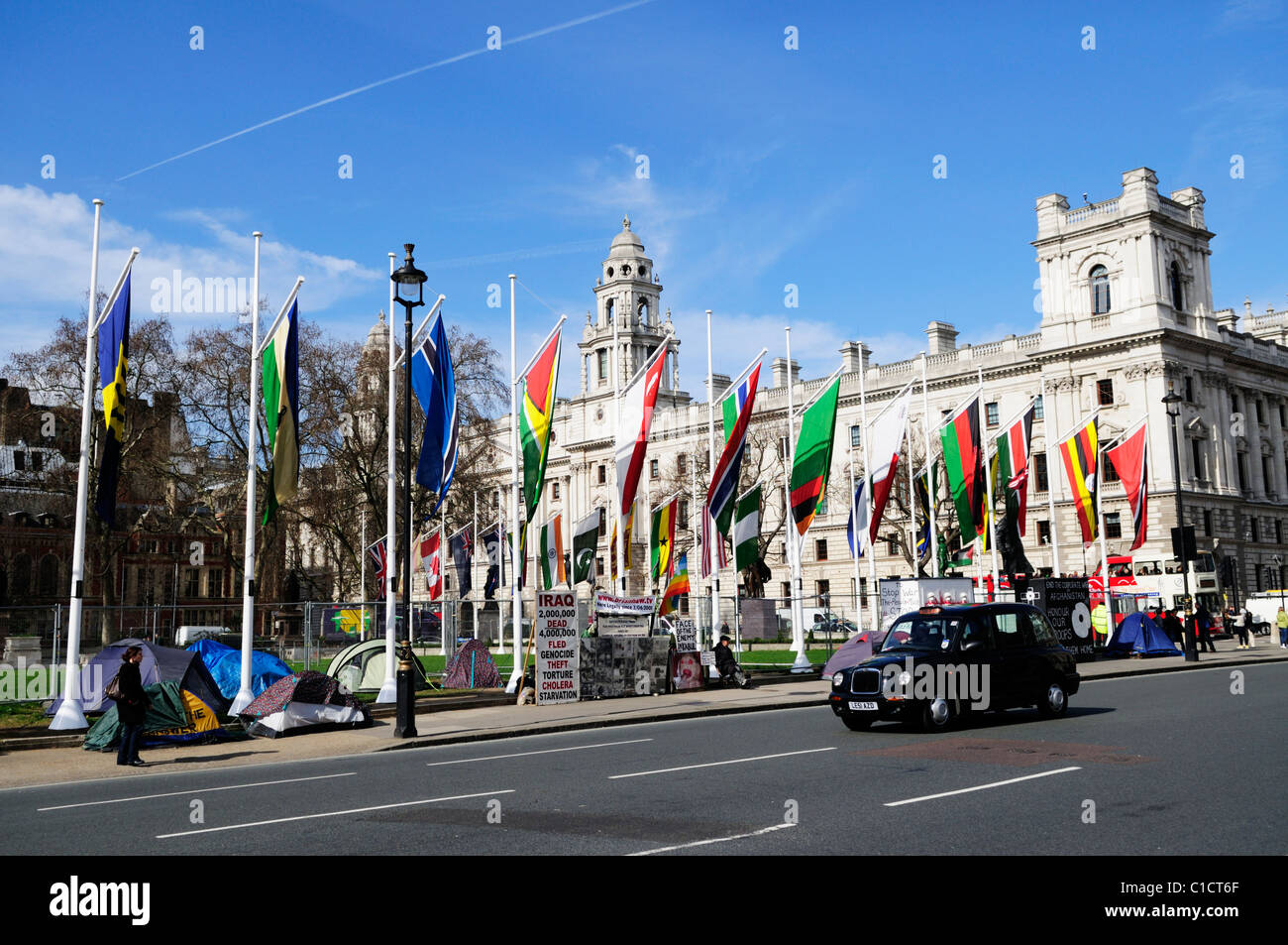 Parliament Square with Anti War Protestors and Flags, Westminster London, England, UK - Stock Image