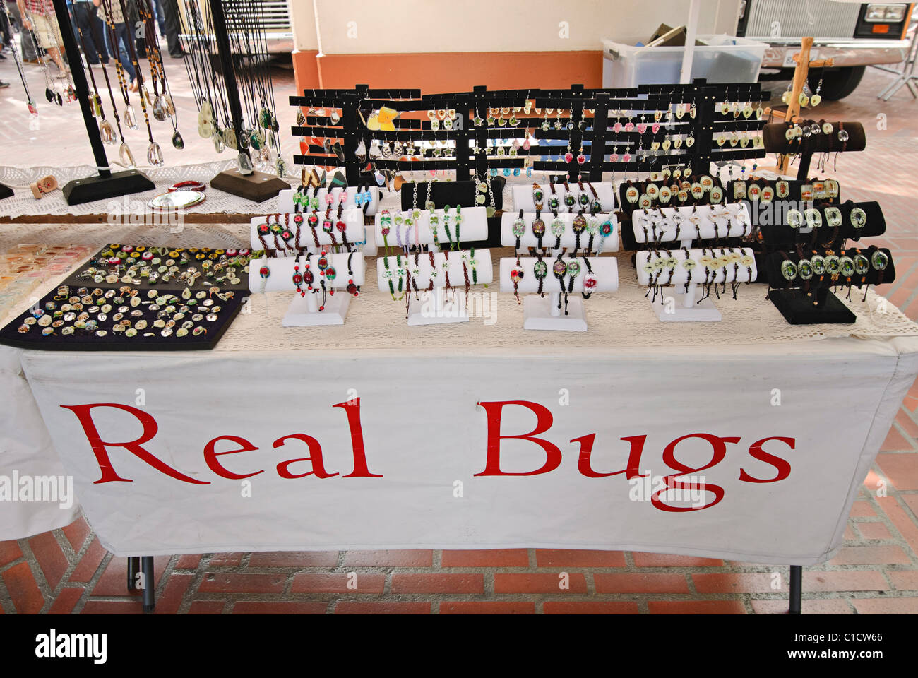 Real Bugs tent sells real insects and bugs in clear resin in many forms including jewelery and decorations. - Stock Image