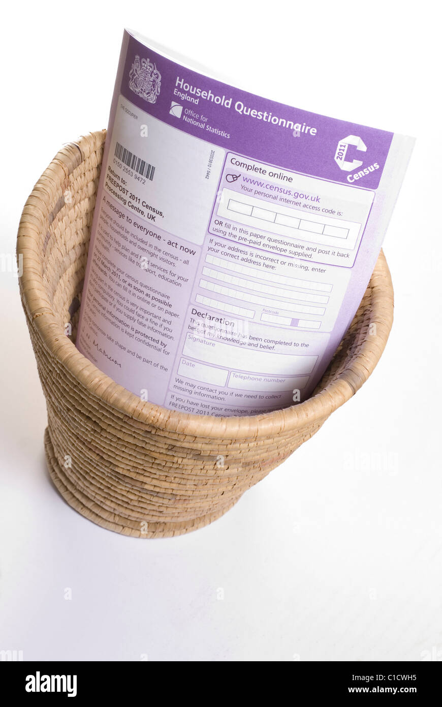 Census 2011 form in a wastepaper basket isolated for cutout or space for text - Stock Image