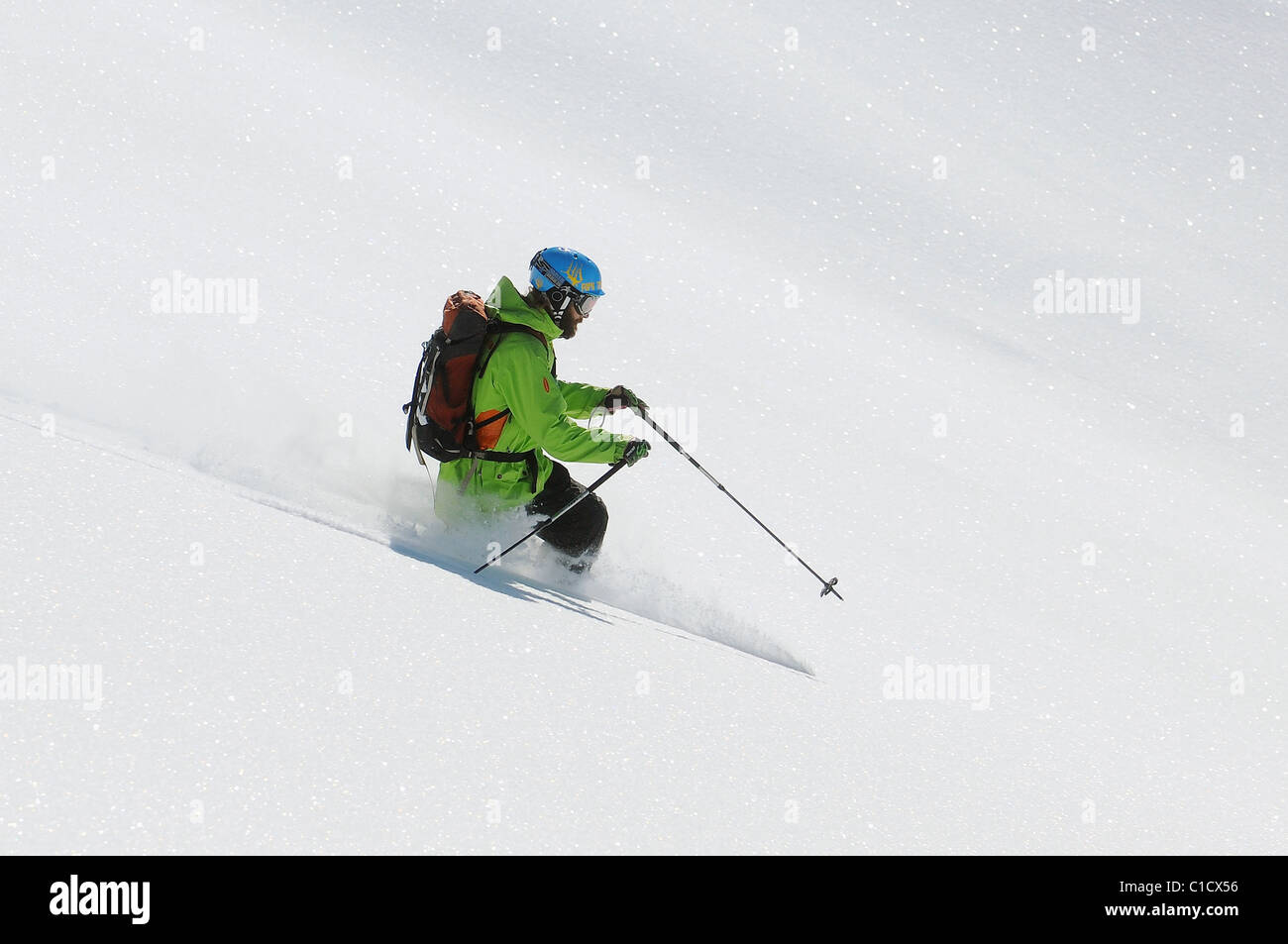 A telemark skier off piste in deep powder snow in the French ski resort of Courchevel. - Stock Image