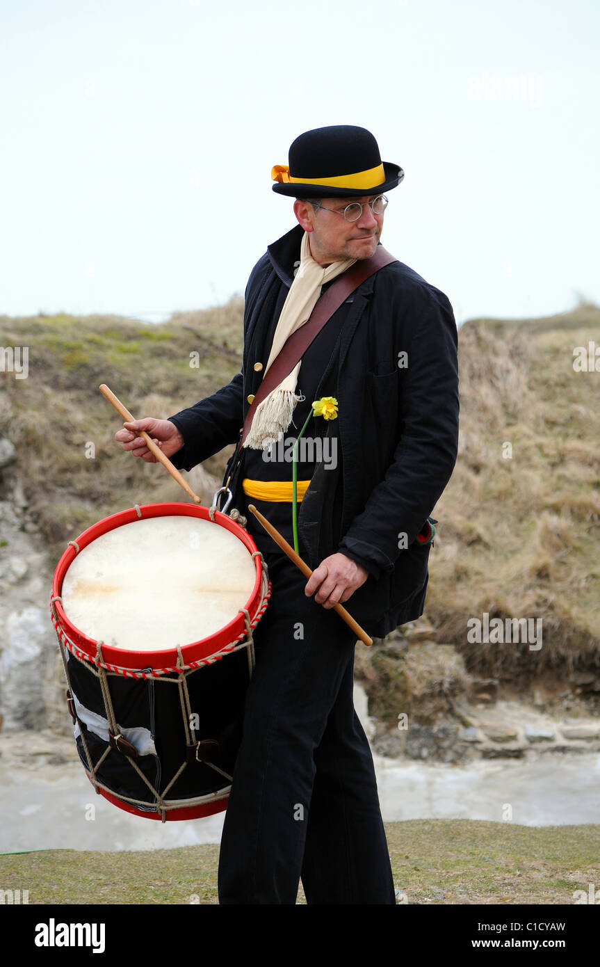 A man drumming in Cornish folk band at the St.Pirans day celebrations in Perranporth, Cornwall, UK - Stock Image