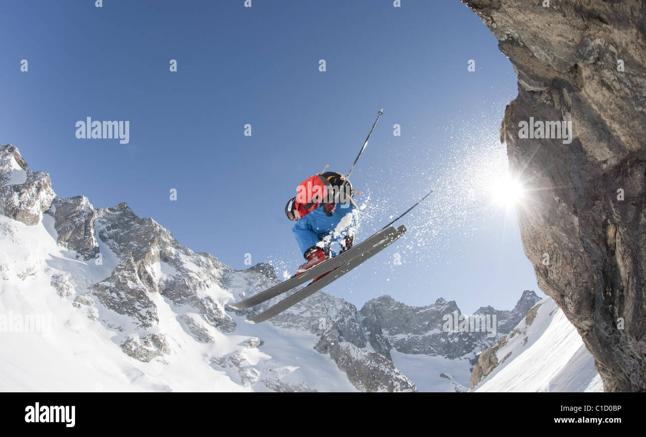 A free skier dropping down a cliff in La Grave, France. - Stock Image