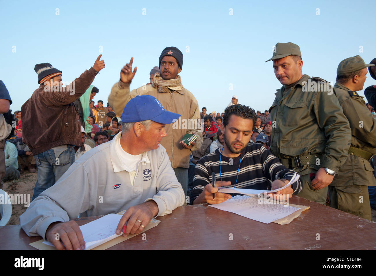 Refugees in the Shousha refugee camp waiting for their return documents, Ben Gardane, Tunisia - Stock Image
