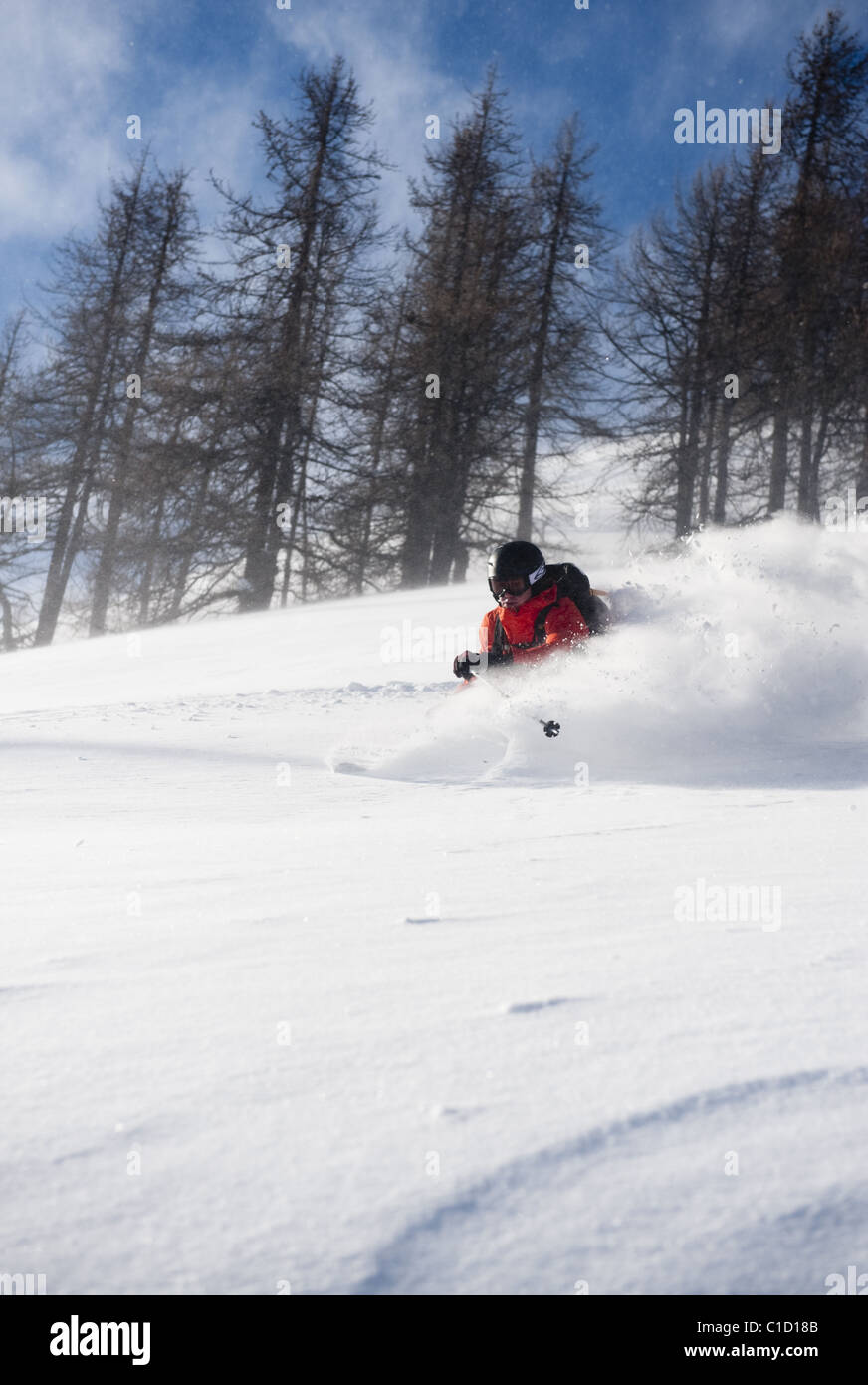 A free skier making a powdery turn in Argentera, Maritime Alps, Italy - Stock Image