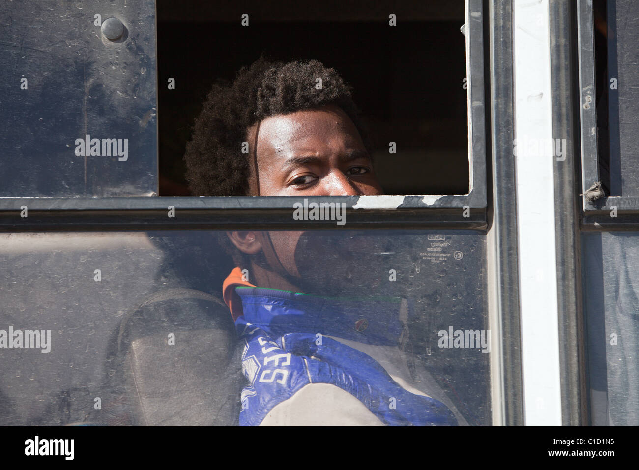 Refugee in a bus on the Tunisian border, Ben Gardane, Tunisia - Stock Image
