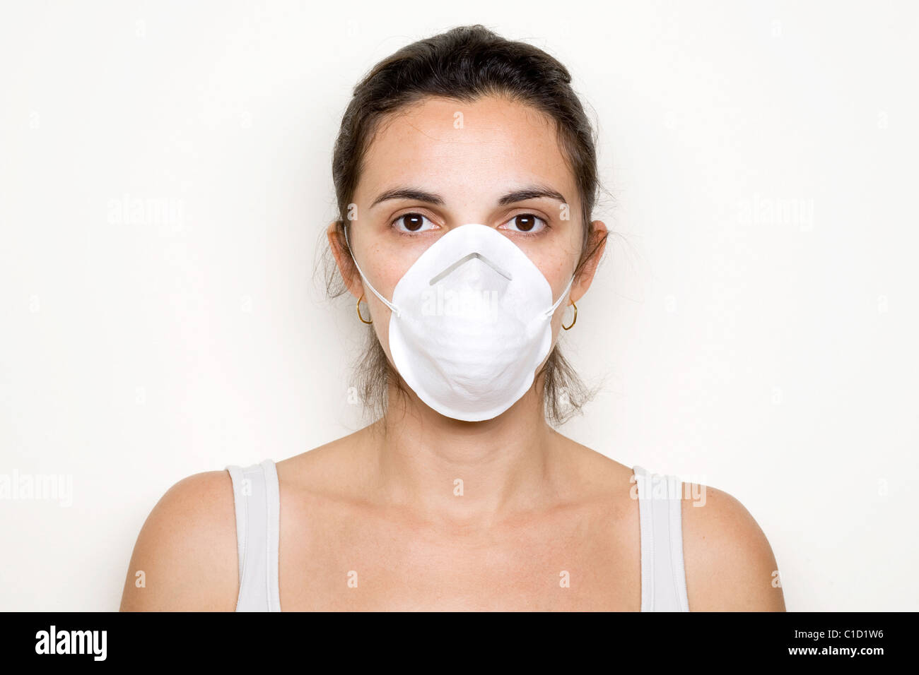 woman with a mask against illness - Stock Image