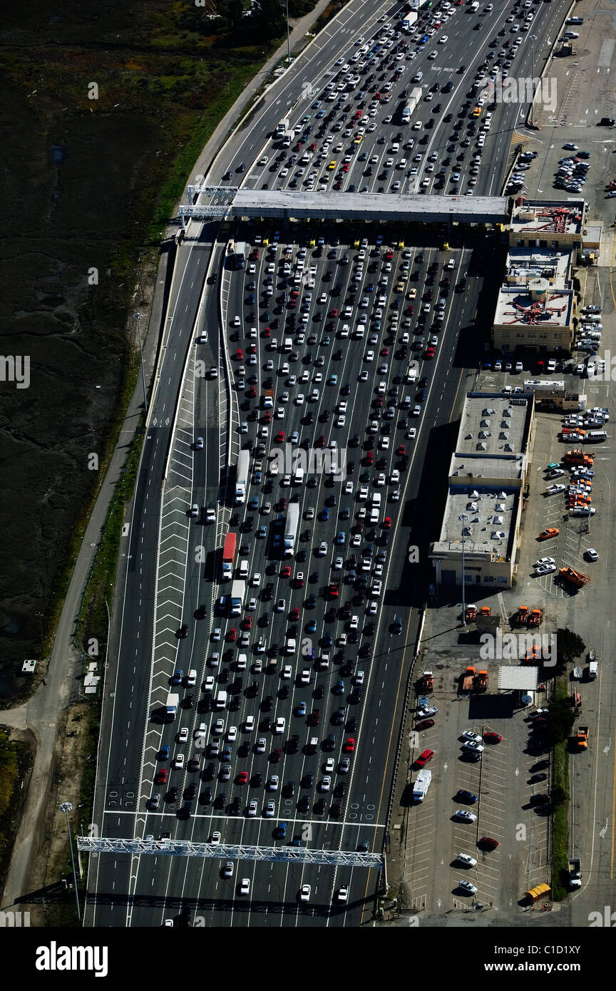 aerial view above heavy traffic at San Francisco Bay Bridge toll plaza Oakland California - Stock Image