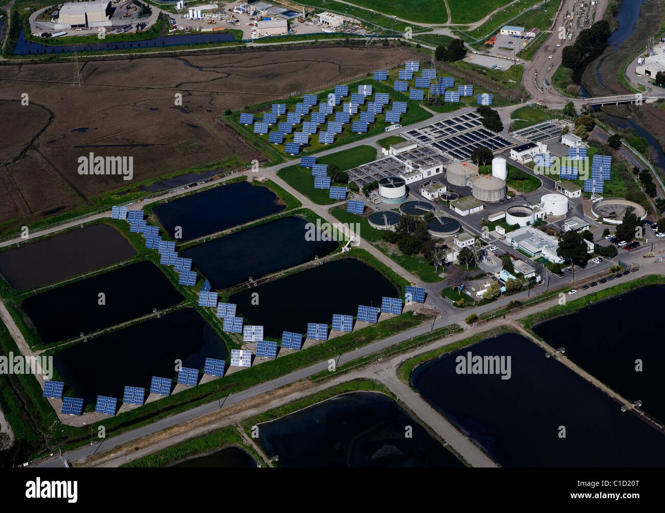 aerial view above solar panel installation wastewater treatment plant Richmond California - Stock Image