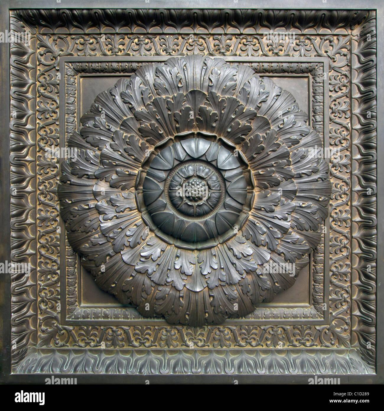 Historic Building Bronze Door Floral Architectural Detail - Stock Image