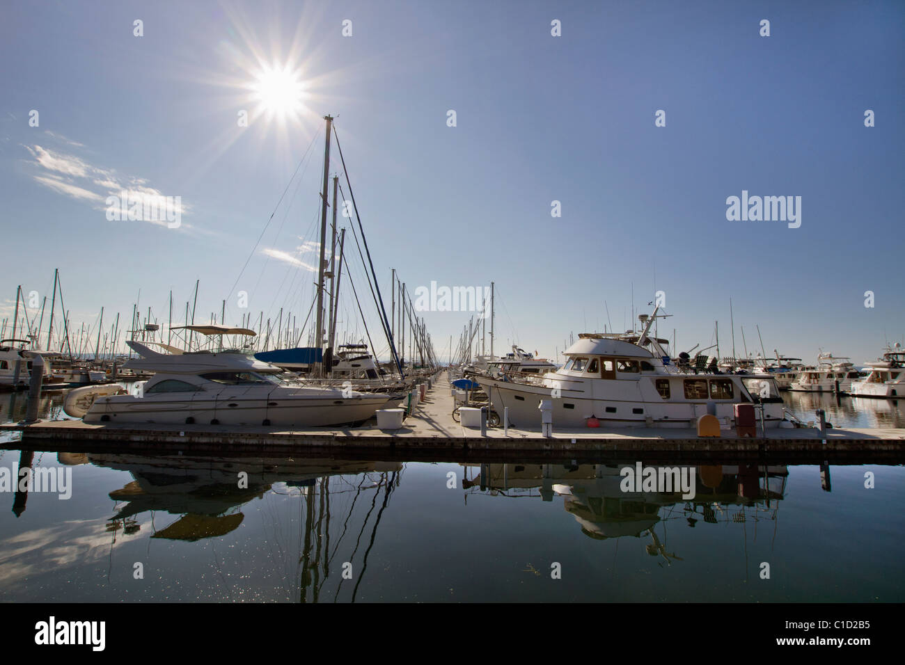Marina Boat Dock with Clear Blue Sky and Water Reflection 2 - Stock Image